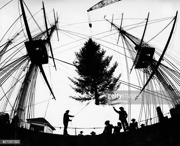 A 25foot Christmas tree is hoisted onto the deck of the USS Constitution in Boston on Dec 6 1988