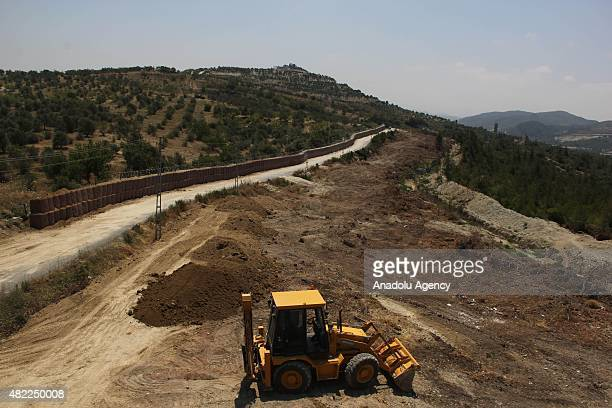 A 25meter high wall is built along the TurkishSyrian borderline to prevent smuggling illegal migration and possible attacks from Syria on July 27...