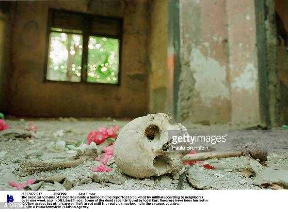 N 357877 017 25Sep99 East Timor The Skeletal Remains Of 2 Men Lies Inside A Burned Home Reported To Be Killed By Militia Over One Week Ago In Dili...