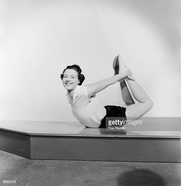 Vera Richardson does a Yoga pose in a keep fit session