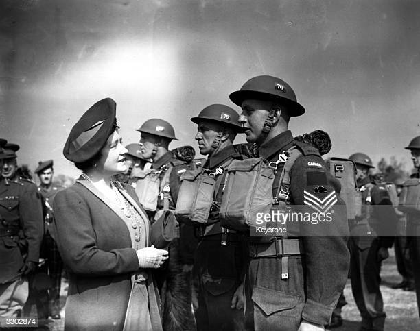 Queen Elizabeth talking to Canadian Army troops during an official inspection