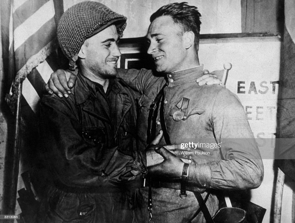 American GI Lt William Roberston greets Russian soldier Lt Alexander Sylvashko, as the historic meeting of the two armies near Torgau on the Elbe.