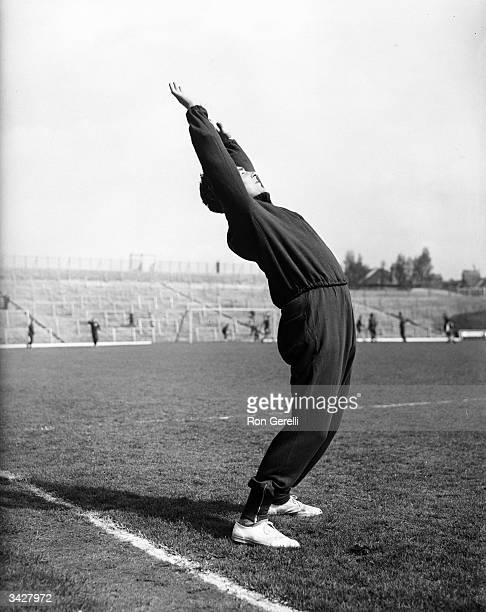 Denis Compton Arsenal footballer and Middlesex and England cricketer keeps fit with a few stretching exercises