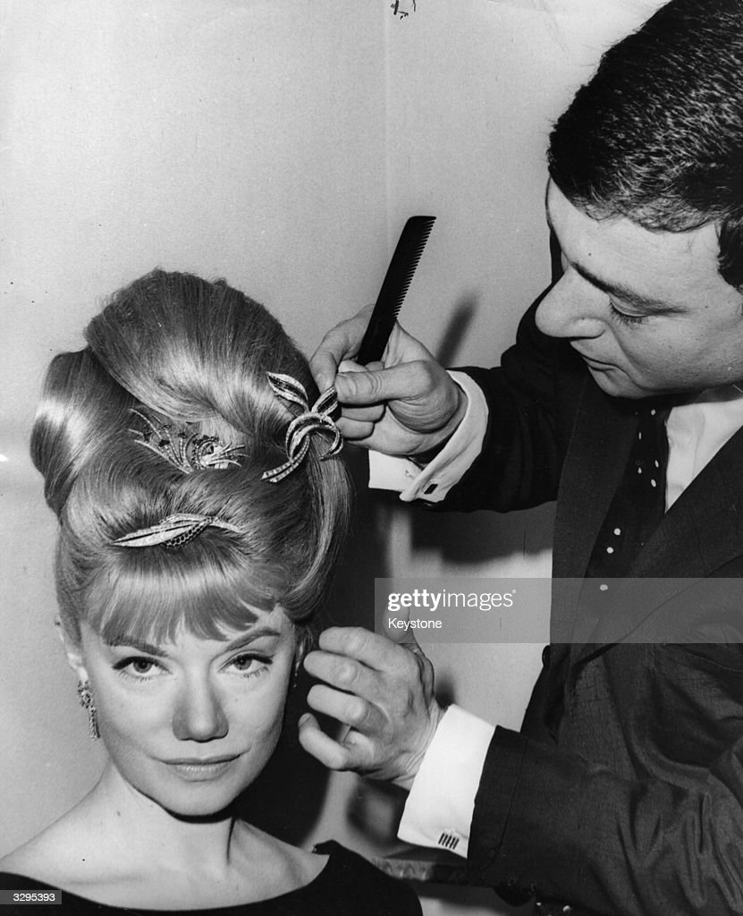 South African opera singer Denny Dayviss has her hair dressed with £10,000 worth of diamonds, loaned by Gerrards the jewellers, by Vidal Sassoon at his salon in Bond Street, London. Dayviss is to sing at a charity ball at the Dorchester Hotel to raise funds for the 'White Fleet' - an organisation which aims to convert vessels belonging to the US Navy into hospital ships to be despatched to disaster areas.