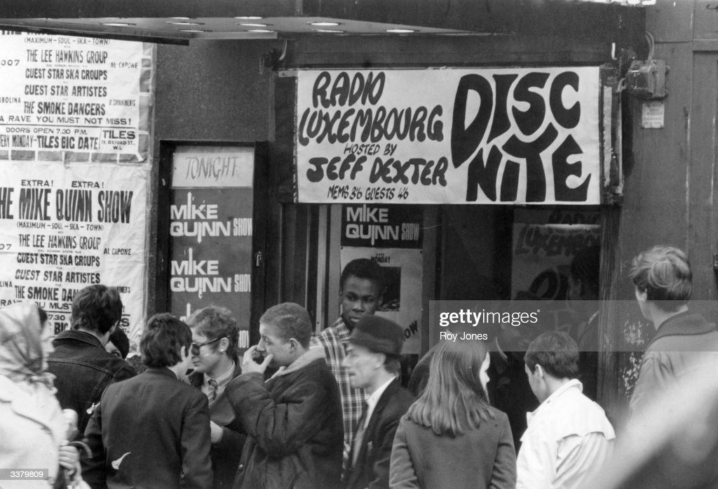 Young mods queuing outside the Tiles Club, 79 Oxford Street, in London's Soho clubland.