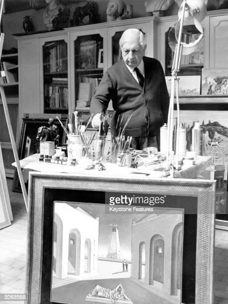 Italian painter Giorgio De Chirico paints in his studio in Rome