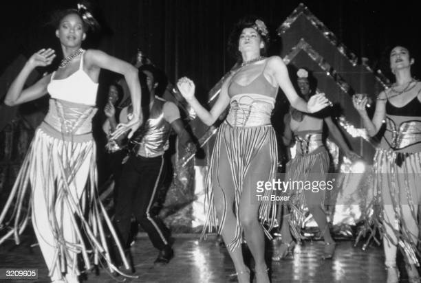 Fulllength view of disco dancers performing in costume at the opening of Studio 54 New York City