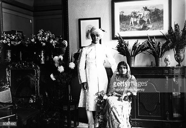 Maharajah Jitendra Narayan of Cooch Behar with his bride Princess Indira the daughter of Gackivar of Baroda on their wedding day