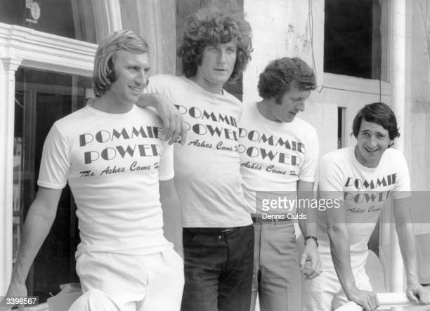 English cricketers John Lever Bob Willis Graham Roope and Derek Randall wearing 'Pommie Power' Tshirts on the balcony at Lord's Cricket ground when...