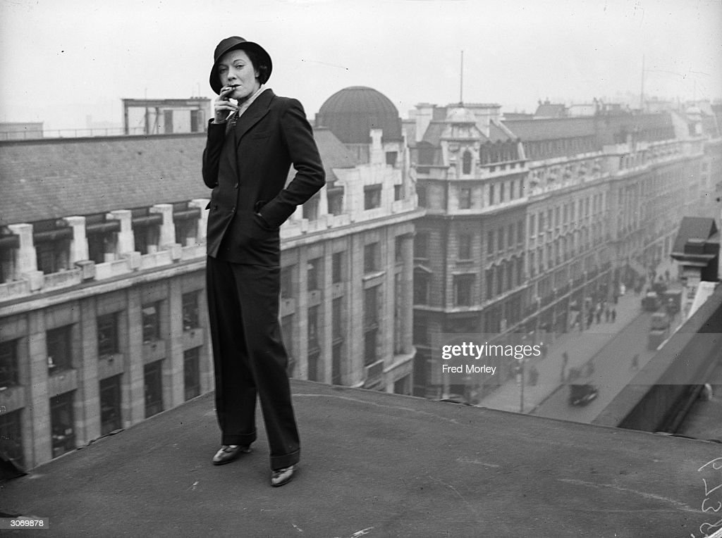 A model stands on a rooftop above Regent Street London wearing the latest Marlene Dietrich fashion of a well tailored man's suit Nicholl's of Regent...