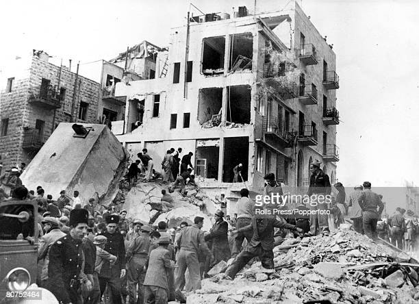 25th February 1948 Jewish rescue workers clambers over blocks of masonry to rescue survivors of Atlantic hotel blast Jerusalem during the Palestine...