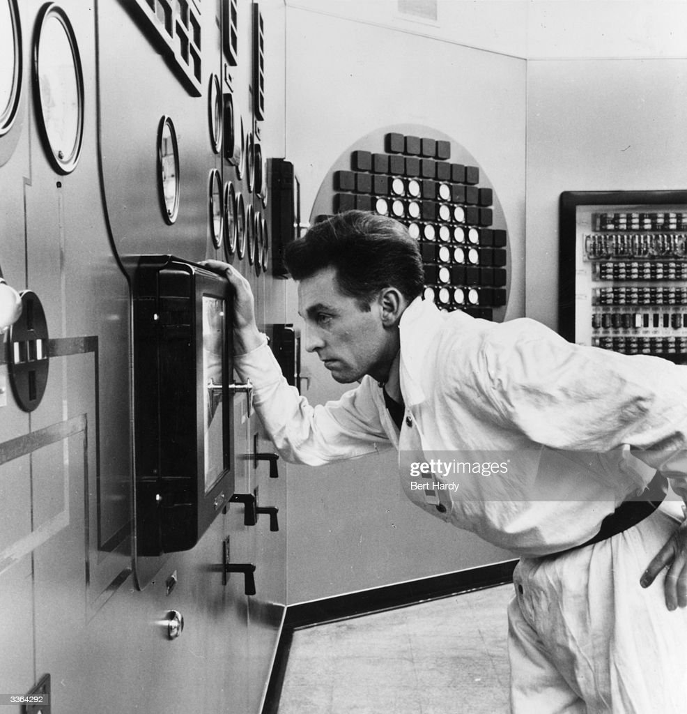 A technician monitors the equipment at Calder Hall in Windscale, Cumbria, Britain's first nuclear power station. Following a narrowly-averted crisis in 1957, the name of the site was changed to Sellafield. Original Publication: Picture Post - 8833 - What Calder Hall Means To You - pub. 1957