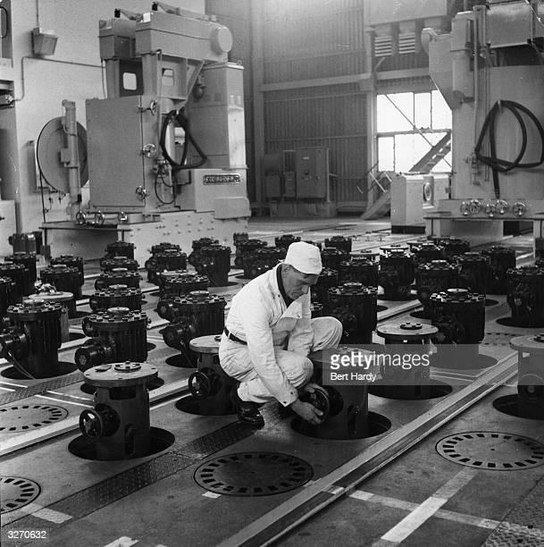 An employee on the charging floor above the reactor core at Calder Hall in Windscale Cumbria Britain's first nuclear power station Following a...