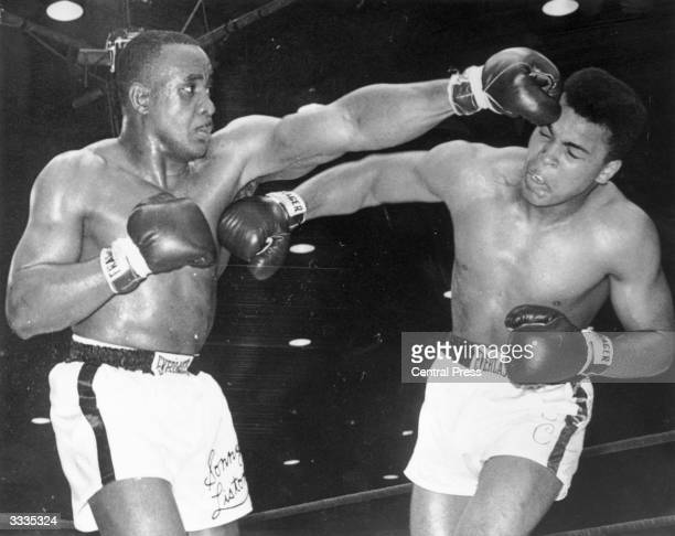 American boxer Cassius Clay later known as Muhammad Ali landing a right to Sonny Liston's body during the World Heavyweight Championship fight at...