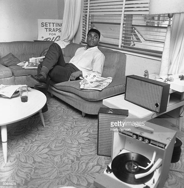 American boxer Cassius Clay relaxing after his world heavyweight victory over Sonny Liston