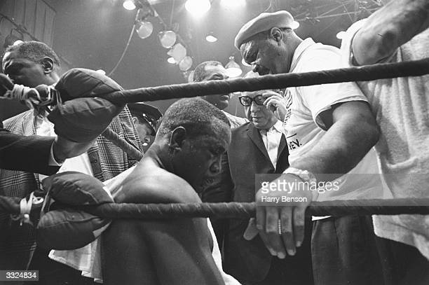 American boxer Sonny Liston sitting in his corner after his world heavyweight title defeat by Cassius Clay at Miami Beach Florida