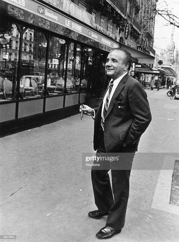 Italian-American ex-boxer Jake LaMotta, world middleweight champion from 1949 - 1951, in a Milan street during a European tour to promote his autobiography, and the film 'Raging Bull' starring Robert De Niro, upon which the book is based.