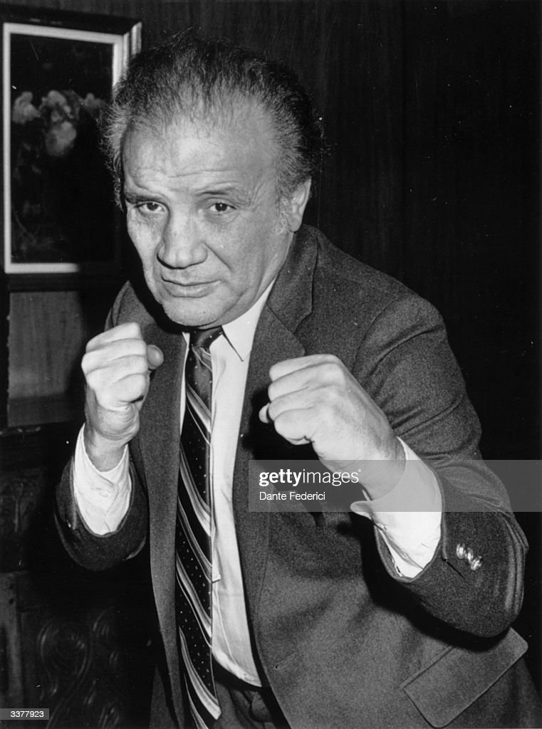 Italian-American ex-world middleweight champion boxer Jake LaMotta pulls a boxing pose in Milan during a European tour to promote his autobiography, and the film 'Raging Bull' starring Robert De Niro, upon which the book is based.