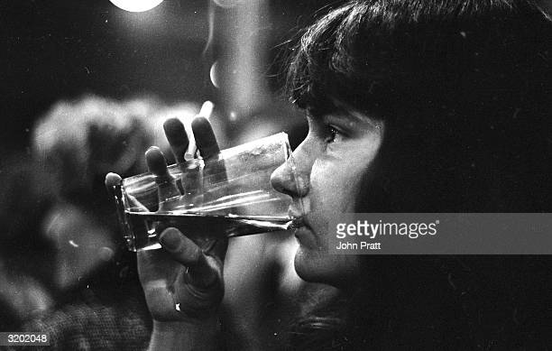 A drinker at the Iron Bridge Tavern in the East India Dock Road in the east end of London The pub has regular performances of oldtime music hall...