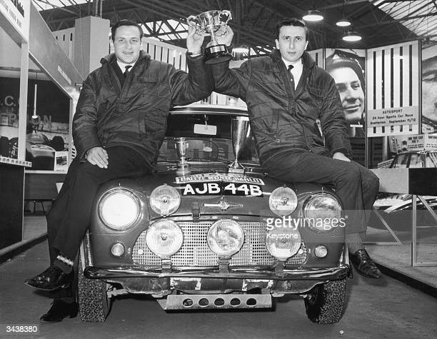 Finnish rally driver Timo Makinen and his codriver Paul Easter hold up their trophy after winning the Monte Carlo Rally The drivers and their Mini...