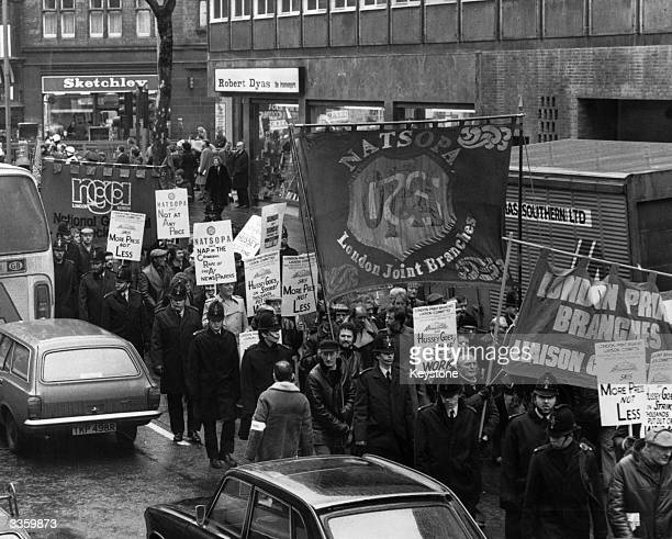 Hundreds of workers from the Times and the Sunday Times newspapers march through Fleet Street and then on to the Times building in Grays Inn Road...