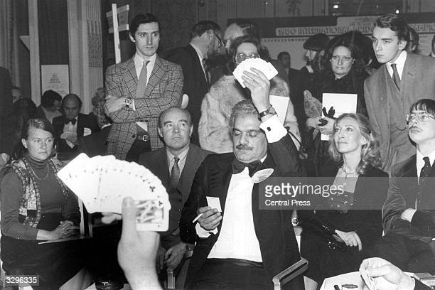 Actor Omar Sharif shows his hand during the Sunday Times International Bridge Pairs Championships at the Hyde Park Hotel London