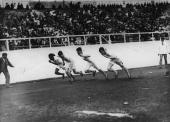 The start of the 400 Metres race at the 1908 London Olympics with William Robbins John Taylor and John Carpenter all of the USA and Wyndham Halswelle...
