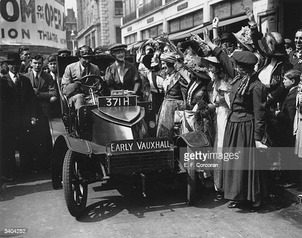 Actress Elaine Earne sets off for a tour in a vintage Vauxhall car from Leicester Square London