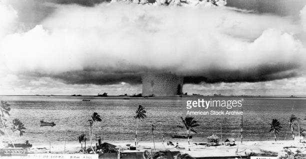 View of a mushroom cloud from a US atomic test explosion rising over the Marshall Islands from the Bikini Atoll in the Pacific Ocean
