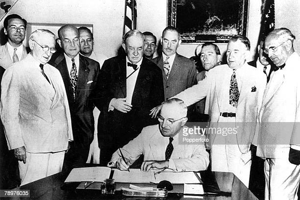 25th July 1949 US President Harry S Truman signs a document which formally ratifies the pact of the North Atlantic Treaty Organization which...