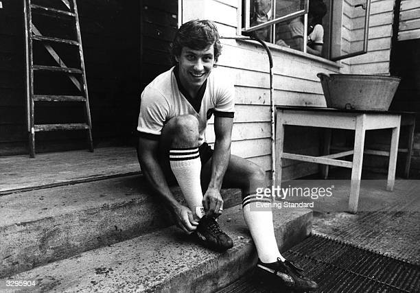 Kenny Sansom who played for Crystal Palace and Arsenal FC ties his shoelaces in preparation for a match