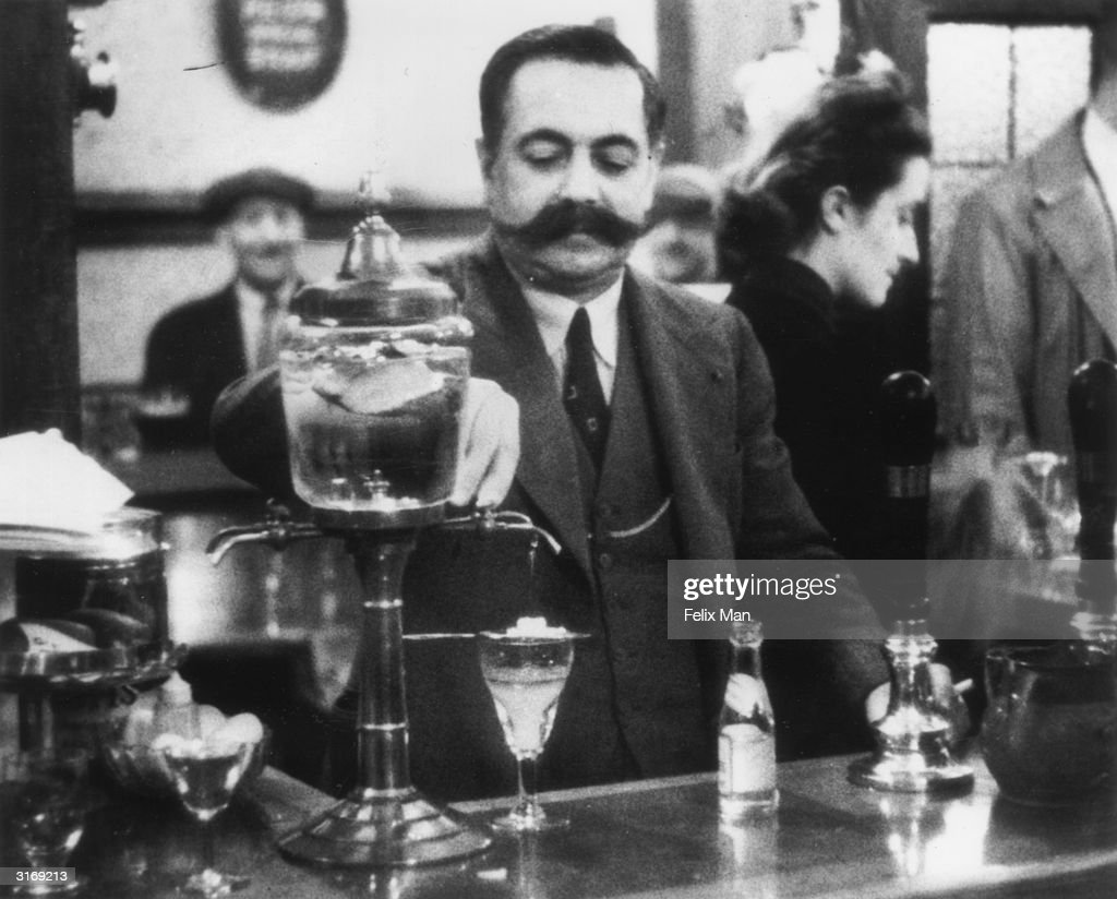 A French publican in London Victor Berlemont mixing absinthe drink His pub the 'York Minster' offers a mixture of English pub and French cafe to Soho...