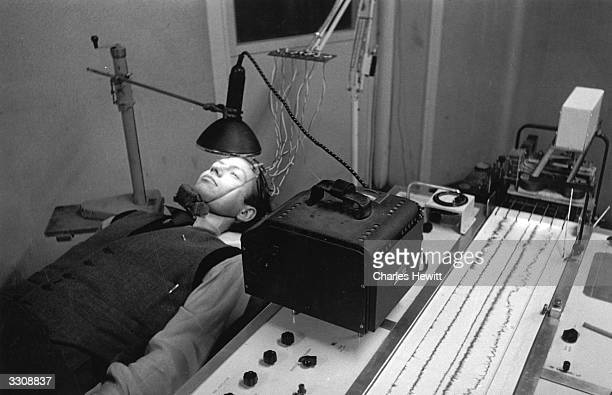 A patient at Bristol University wearing an encephalogram machine which will trace the electrical impulses emitted by his brain Original Publication...