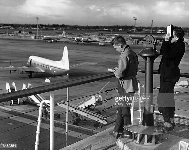 Airplane spotters Brian Maylon and Brian Gray in the public enclosure at London Airport