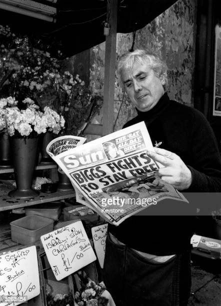 The Great Train Robber 'Buster' Edwards reads Sun newspaper article about his companionincrime Ronnie Biggs