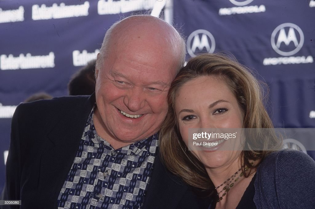 Headshot of American acting coach Burt Lane and his daughter, American actor Diane Lane, leaning their heads together and smiling while at the Independent Feature Project/West Independent Spirit Awards, where Diane was nominated as Best Female Lead for her performance in director Tony Goldwyn's film, 'A Walk On the Moon,' Santa Monica, California.