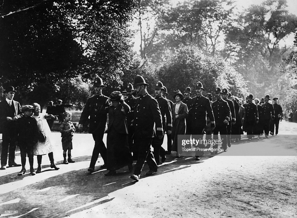 A procession of arrested suffragettes passing through St James' park after their attack on Buckingham Palace.