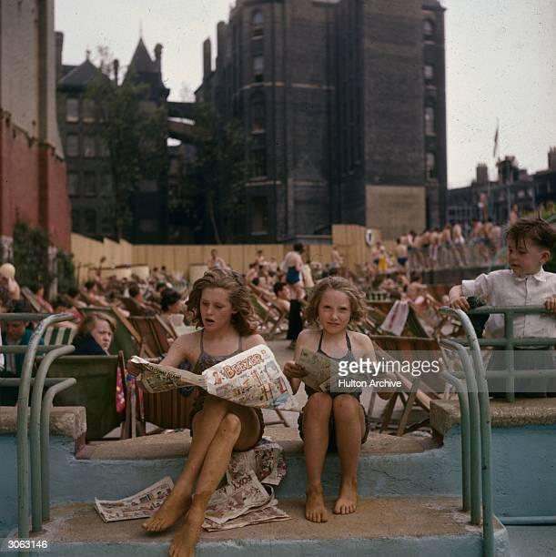 Sun worshippers and swimmers relax at the Oasis outdoor swimming pool in Holborn London