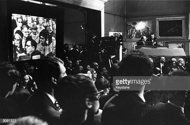 A painting by Winston Churchill on sale at Sotheby's with bidders from New York being shown on the large television screen via the Early Bird...