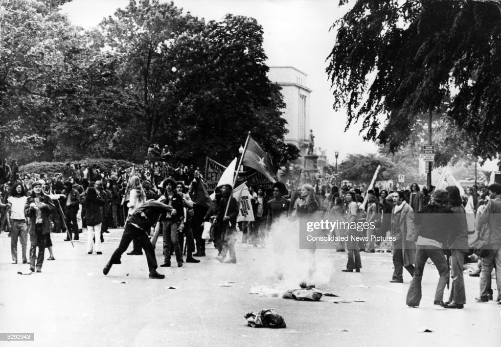 People demonstrating against American involvement in the Vietnam War throw rocks at the police during a demonstration in Washington DC. The police used tear gas to break up the demonstration and made mass arrests.