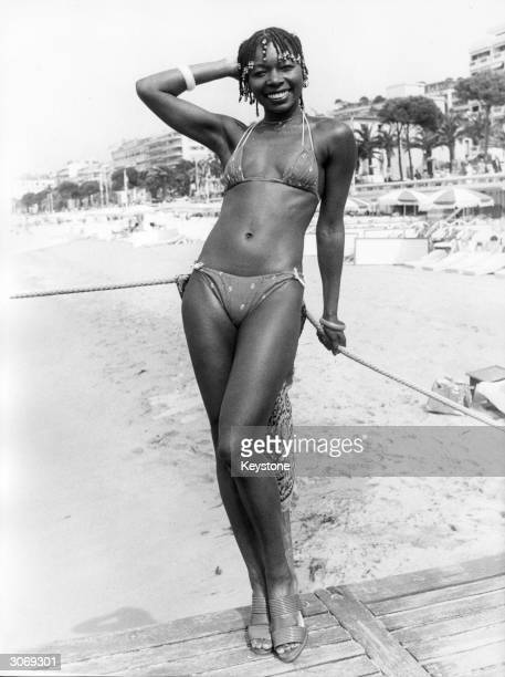 British actress and television presenter Floella Benjamin poses on the beach at Cannes in her bikini She is attending the film festival as one of the...