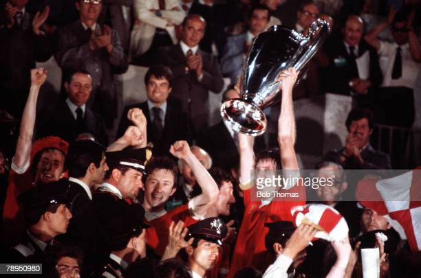 25th May 1977 Rome Italy European Cup Final Liverpool 3 v Borussia Moenchengladbach 1 Liverpool captain Emlyn Hughes lifts the European trophy after...