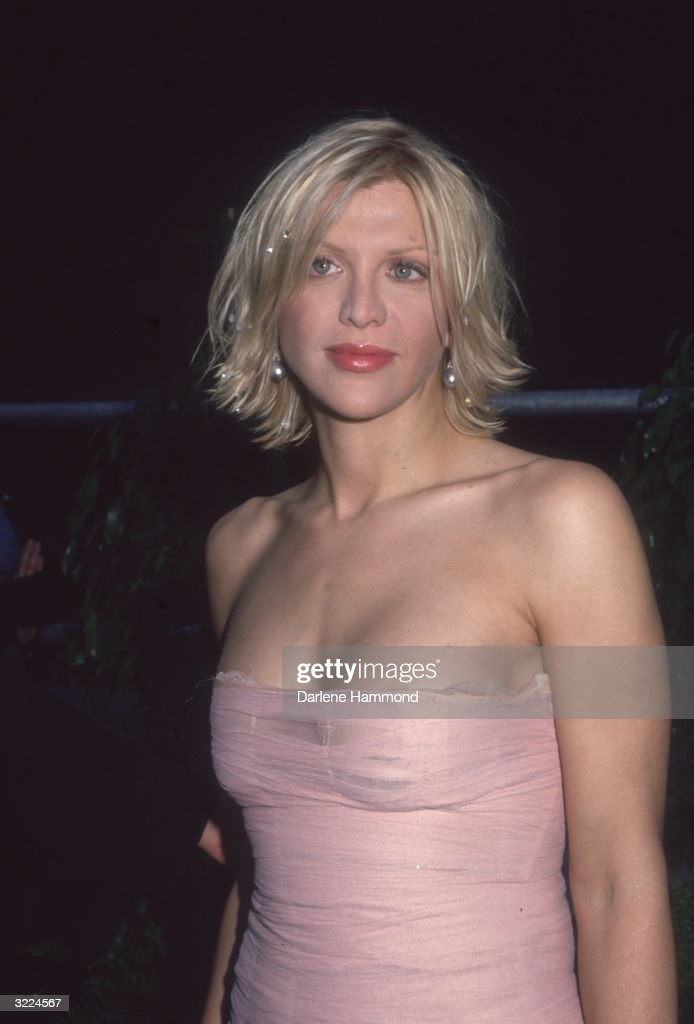 American musician and actor Courtney Love wearing a pink Versace dress at the Fifth Annual Blockbuster Entertainment Awards, Shrine Auditorium, Los Angeles, California.