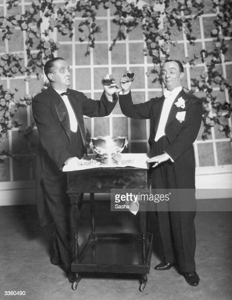 British comedy actors Sydney Howard and Leslie Hanson in a drunken scene from the hit new musical comedy 'Funny Face' at the Princess Theatre