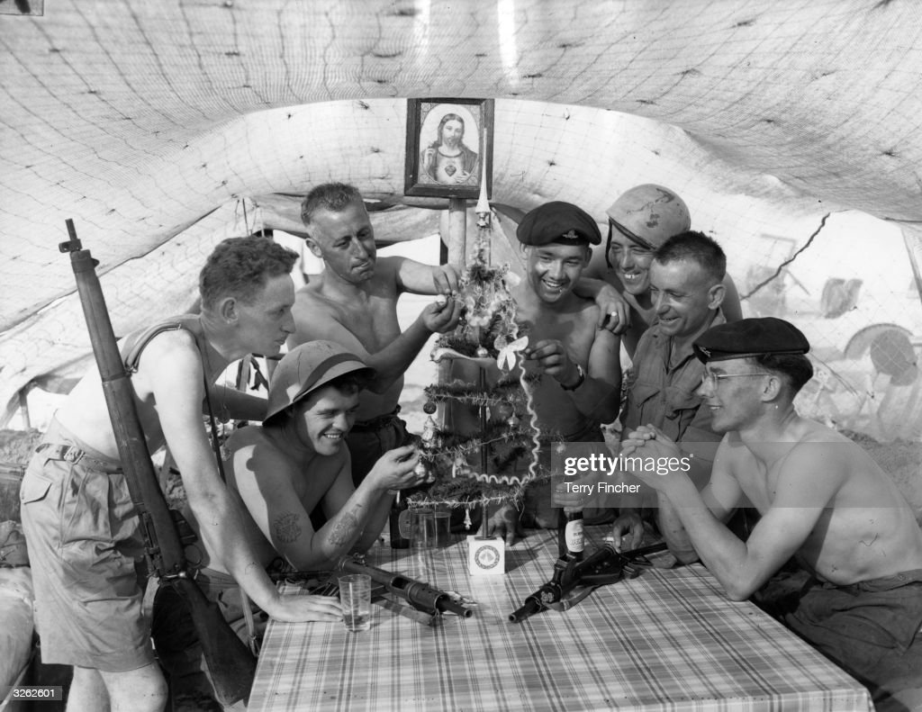 British troops decorate a Christmas Tree in their dugout during the Suez Crisis.