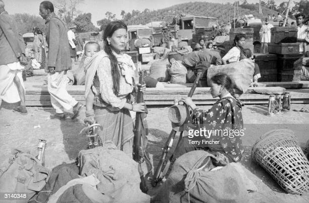 Some of the wives and families of soldiers of the Assam Rifles at Tezpau in India during border clashes with China