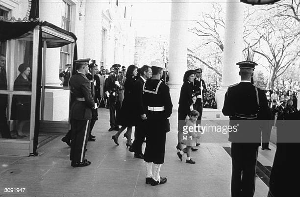 Jacqueline Kennedy the wife of the assassinated President with her children John Jnr and Caroline at her husband's funeral The President's brother...