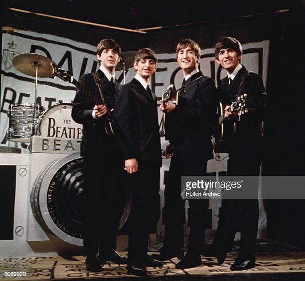 Liverpudlian beat combo The Beatles from left to right Paul McCartney Ringo Starr John Lennon and George Harrison performing in front of a...
