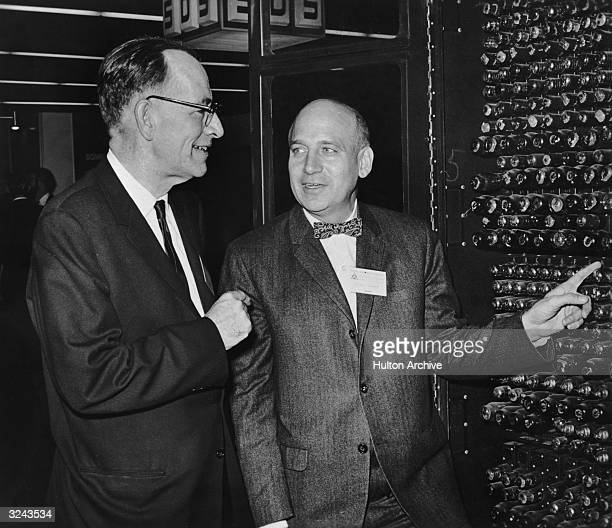 American engineers John Mauchly and Dr Presper Eckert Jr look at a portion of ENIAC which they codesigned in 1946 Mauchly and Eckert are at the Fall...