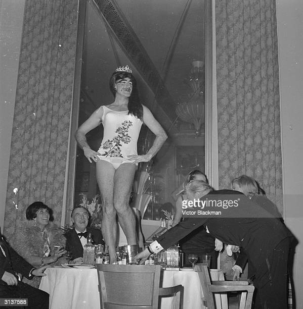 British racing driver Graham Hill wins a mock beauty pageant and claims the coveted title of 'Miss Earth'